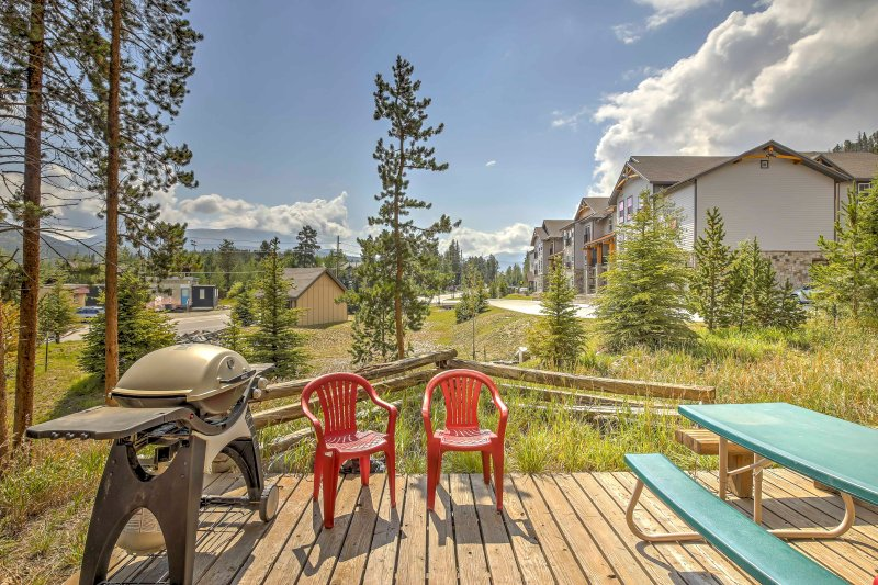 The condo has a private deck with a picnic table, chairs, and mountain views!