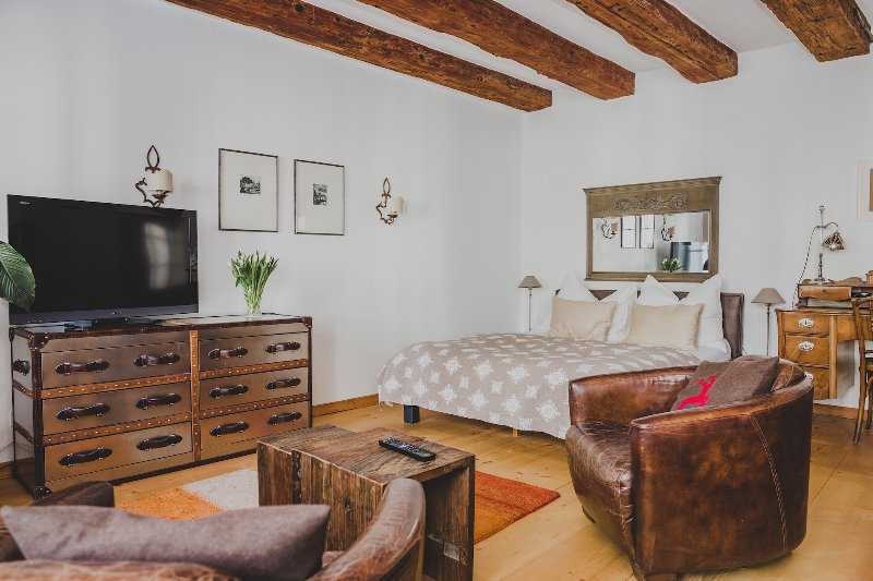 Spacious room with exposed beams
