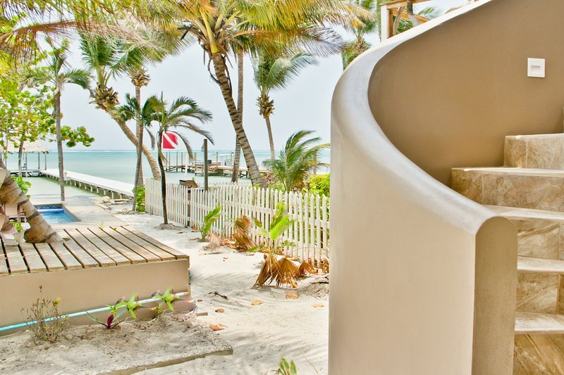 Conch-shell stairway to rooftop, beach access & Seastar Belize/The Dive Bar Belize is 20 steps away!