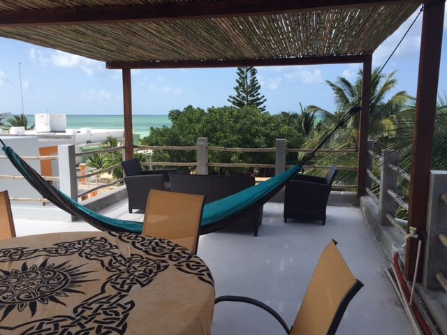 Rooftop terrace with lots of seating areas, overlooking the Gulf Of Mexico