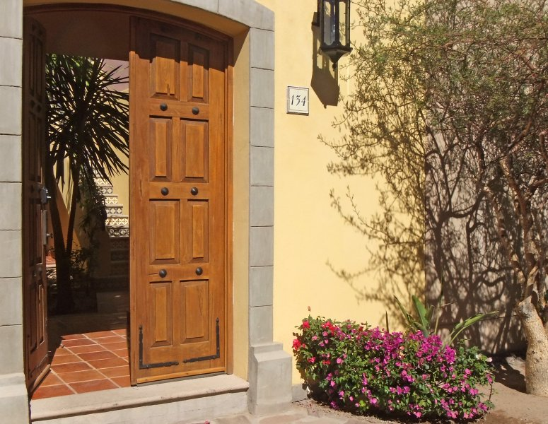 Our open door welcomes you into the landscaped inner courtyard, to make you feel at home.