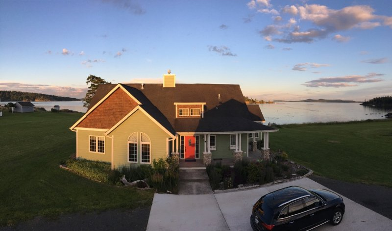 The house in front of the water at sunset