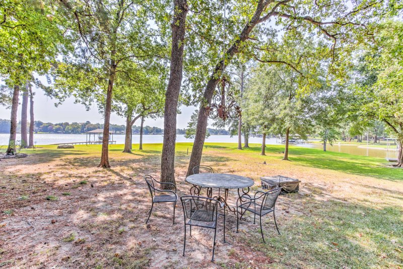 Experience everything that the Cedar Creek Lake has to offer from this beautiful 4-bedroom, 2-bathroom vacation rental cabin that's located directly on the shoreline.