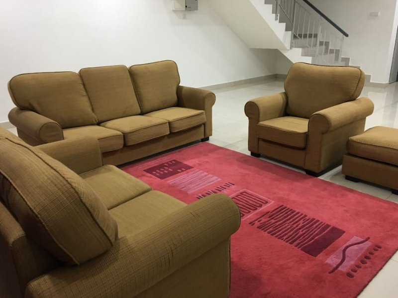 This is a picture of the living hall, equipped with sofa set and TV.
