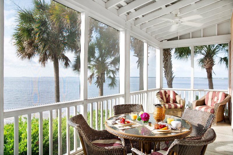 Private screened-in porch with hammock.