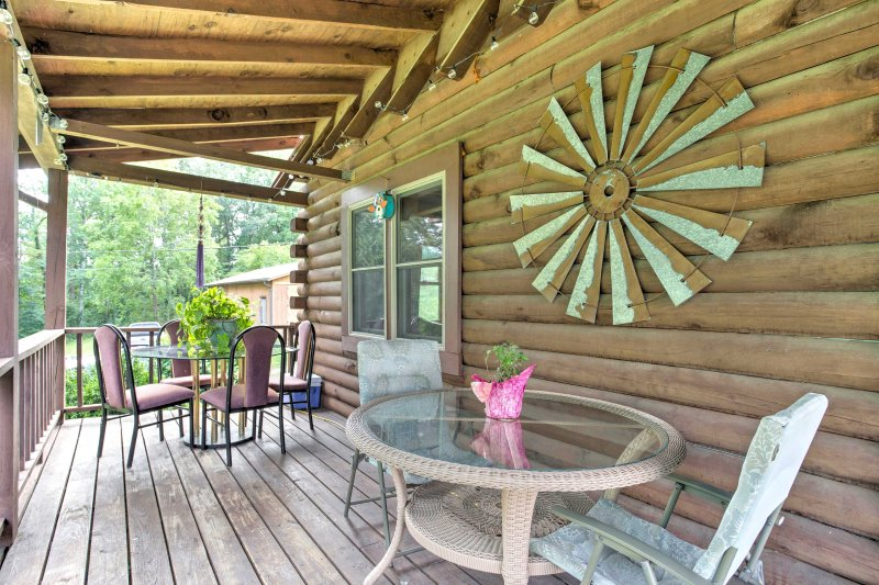 A country getaway awaits at this lovely Fletcher vacation rental cabin.