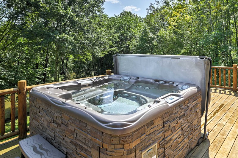 Soak in the hot tub, which overlooks the Shawangunk Kill, during your stay at this 4-bedroom, 3-bathroom vacation rental house in Pine Bush.