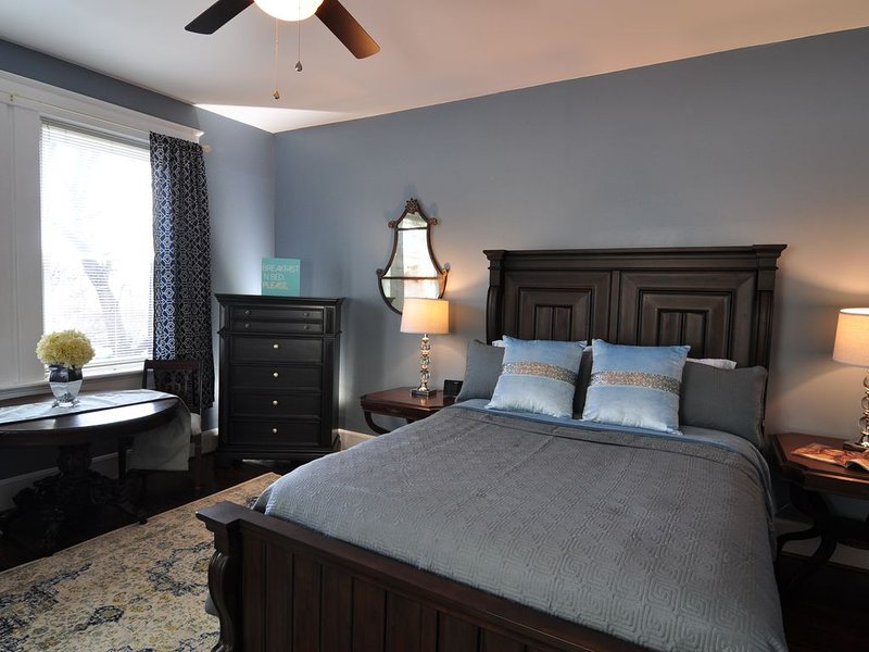 A big comfy queen bed with antique treasures to walk you back into Greenville of the 1920's
