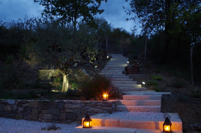 The steps up to the pool from the kitchen terrace at night.