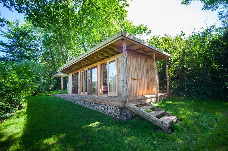 Jake's Cabin built from local cedar and larch and eco friendly and re-cycled materials.