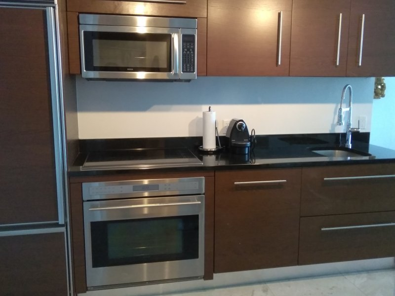 Modern luxury kitchen with complete dinning set