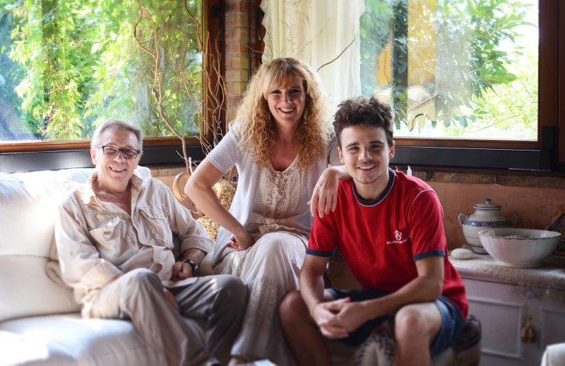 A família proprietária do hotel. Gianni, Antonella e Eugenio
