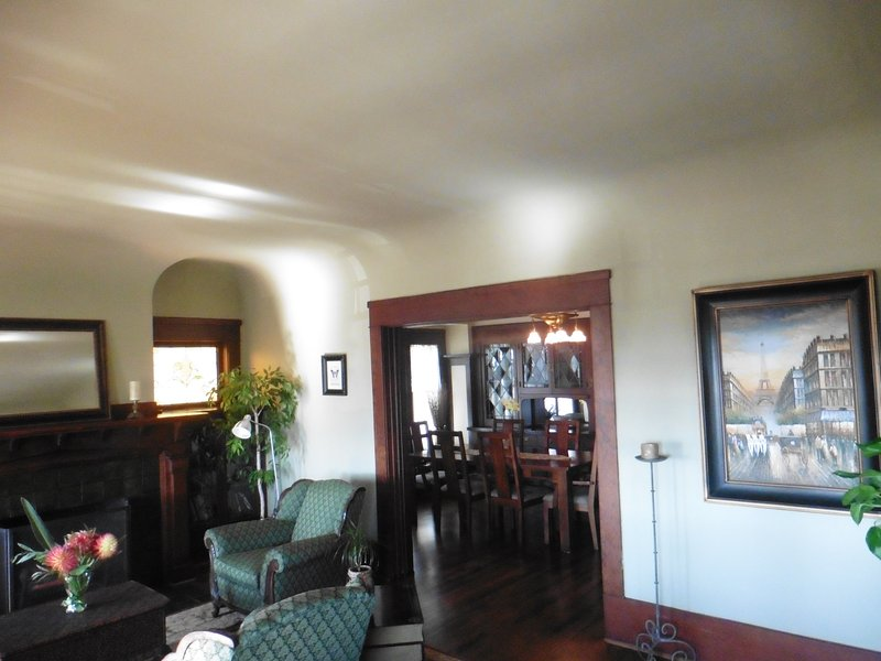 intricate details of ceiling smoothly flowing into walls, wood trim, stained glass windows & firepla