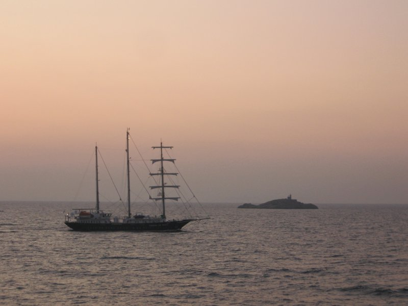 Sunset with sailing ship.