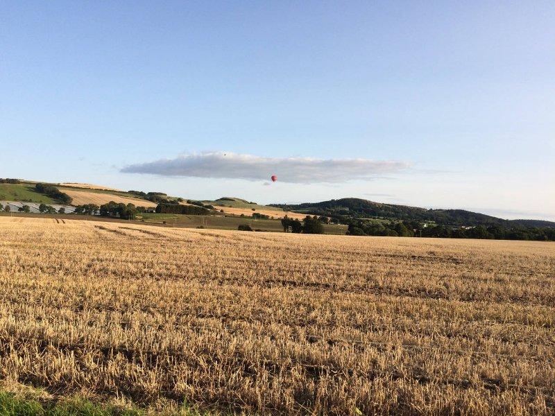 Virgin balloon over hills in front of Summerfield View