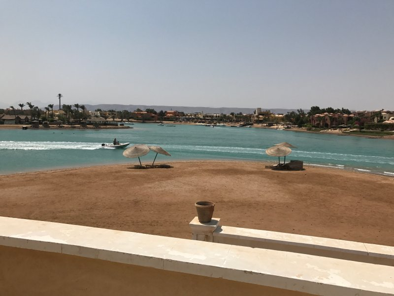 view to beach sunloungers