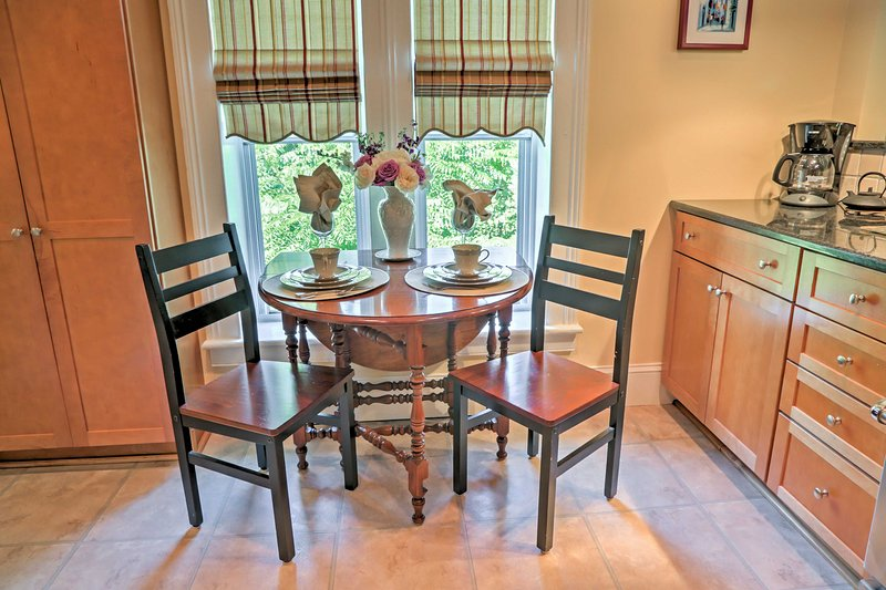 Gather around the 2-person dining table to enjoy meals with your loved one.