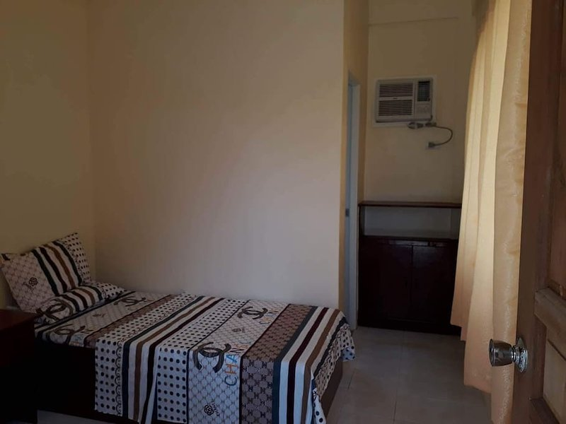 Rising Sun Pension House Room B, vacation rental in Oslob
