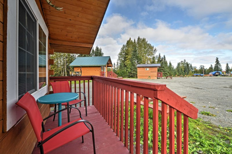Kickback and relax on the furnished front porch and soak in the serene forest surroundings.