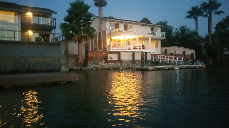 Our house from water at night. After the magnificent sunset, relax on the deck.