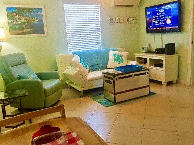 Beautiful new living area features Widescreen TV, DVD WiFi, Unlimited calling Recliner Sleep Futon!