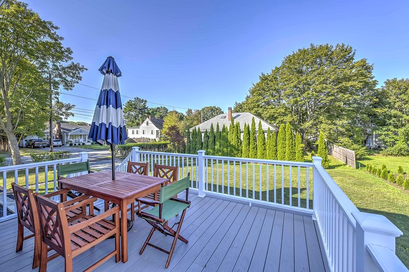 The property features a deck with outdoor furnishings that overlooks the yard.