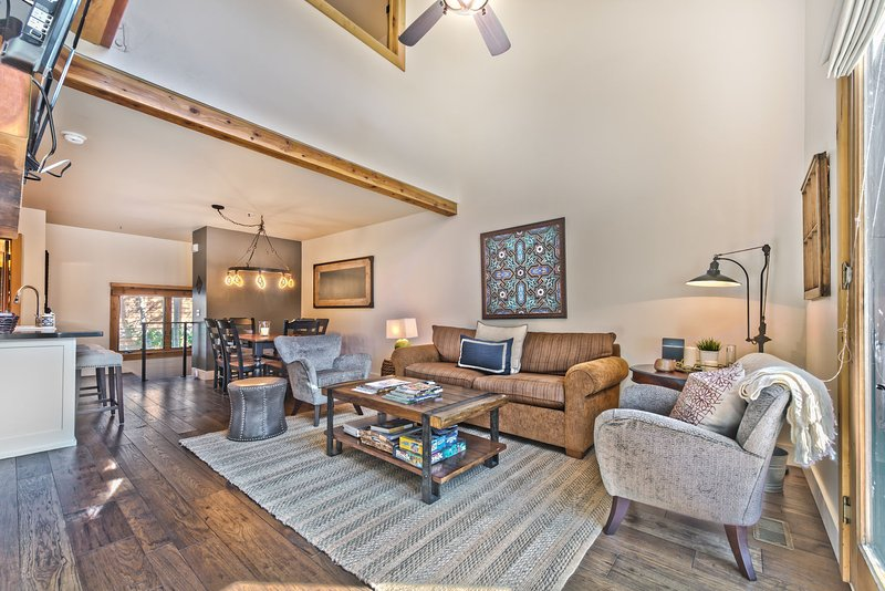 Living Room with Cozy Mountain Contemporary Furnishings, Gas Fireplace and Large Smart TV