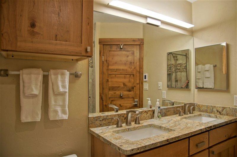 Bathroom 2 has dual sinks