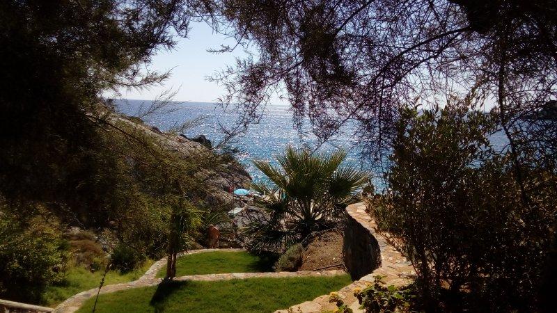 Ammoudaki beach (1 km away)!