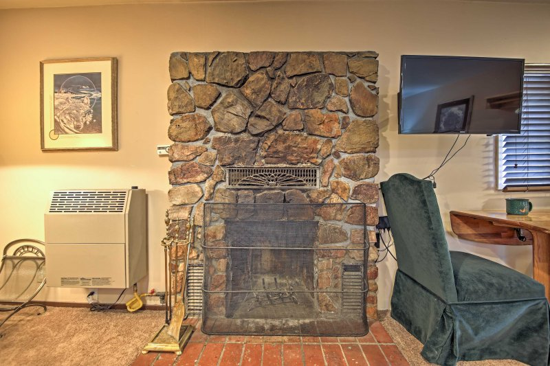 This wood-burning stone fireplace will keep everyone in your group nice and warm during the colder months.