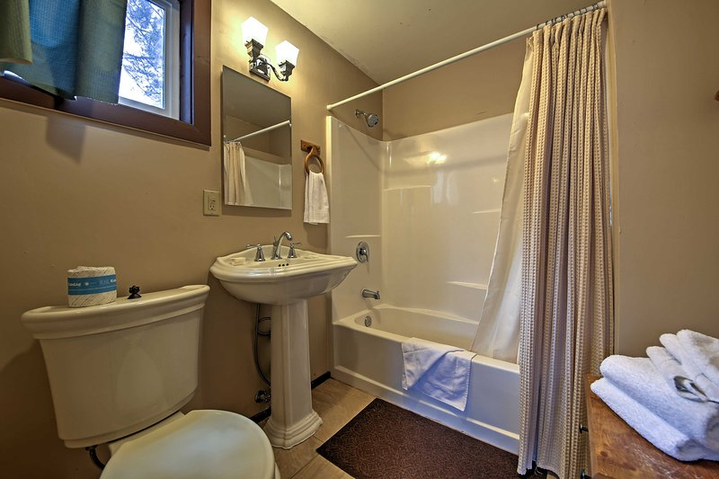 The bathroom comes complete with a spacious shower/tub combo.