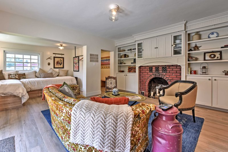 Cozy up by the fireplace and enjoy the relaxing atmosphere in this remodeled cottage.