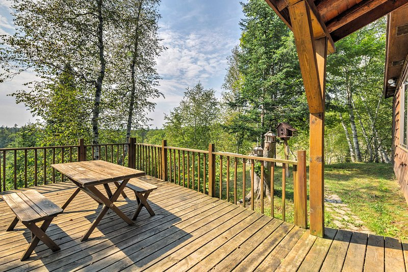 The property has a deck with a picnic table overlooking the beautiful hillside.