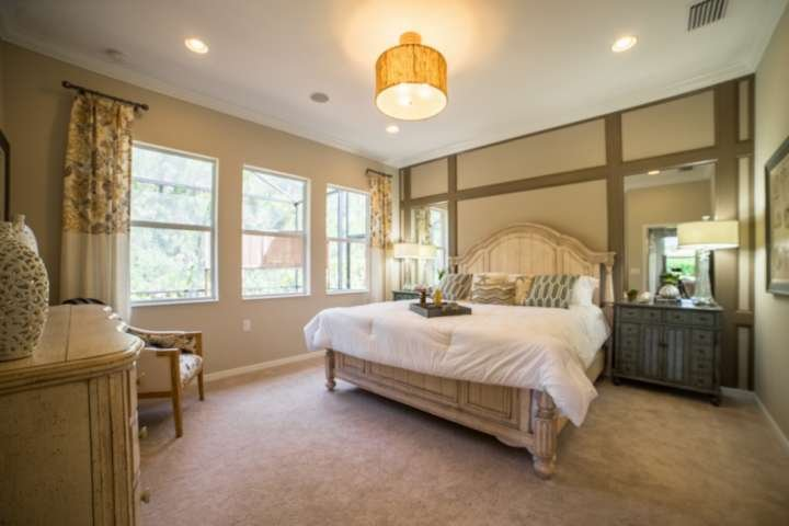 Simply stuning master suite with king sized bed and gorgeous view of lanai and preserve beyond.