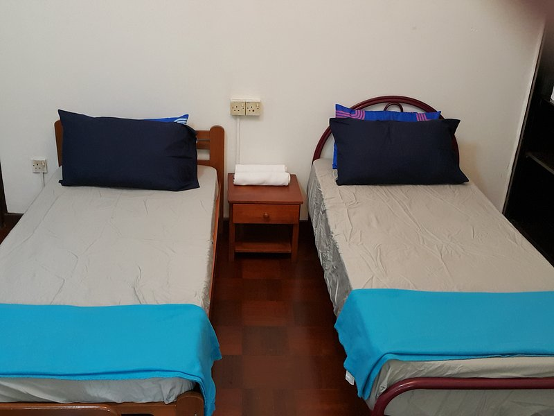 Room 111 with 2 single beds.