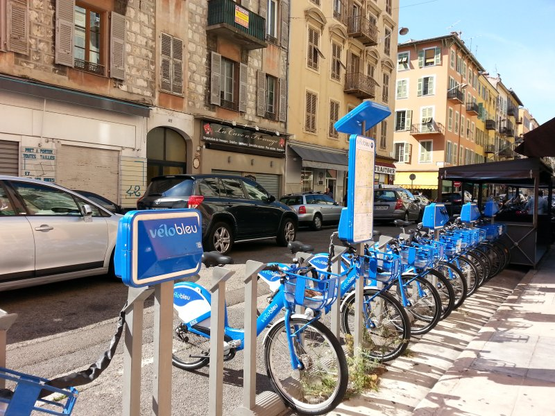 """Sation """"blue bike"""" at the foot of the building"""