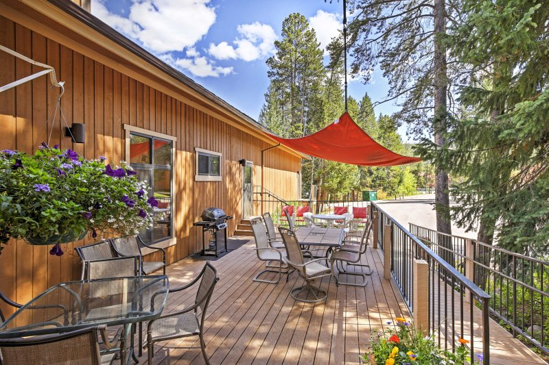 The community patio offers lush views and a gas grill.