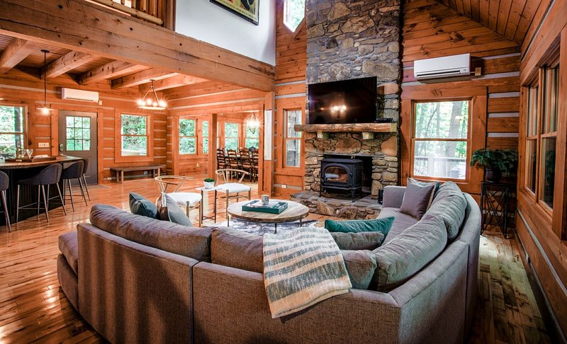 The great room with vaulted ceilings is a perfect space to gather with family and friends.