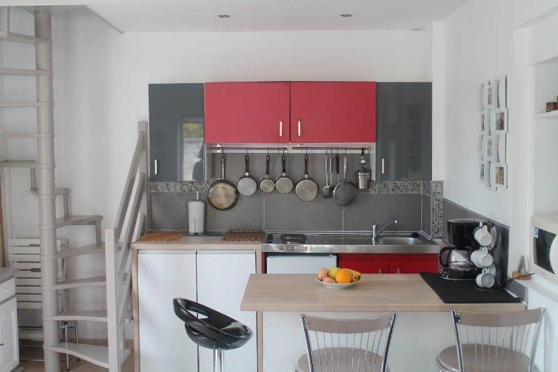 Kitchen + spiral staircase
