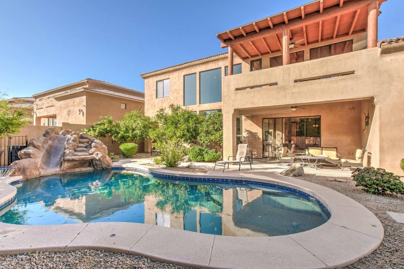 Relax by the pool and take a dip in the refreshing water during your stay at this 4-bedroom, 3-bathroom vacation rental house in Phoenix.