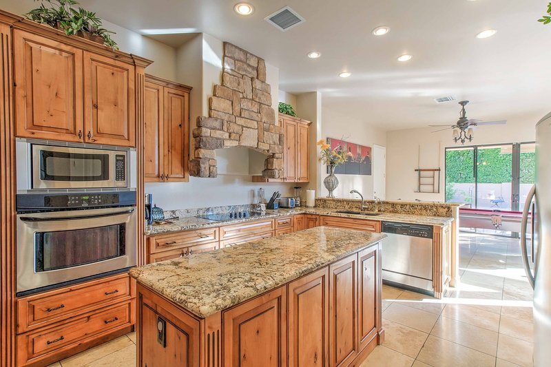 Granite counters are the highlight of the kitchen.
