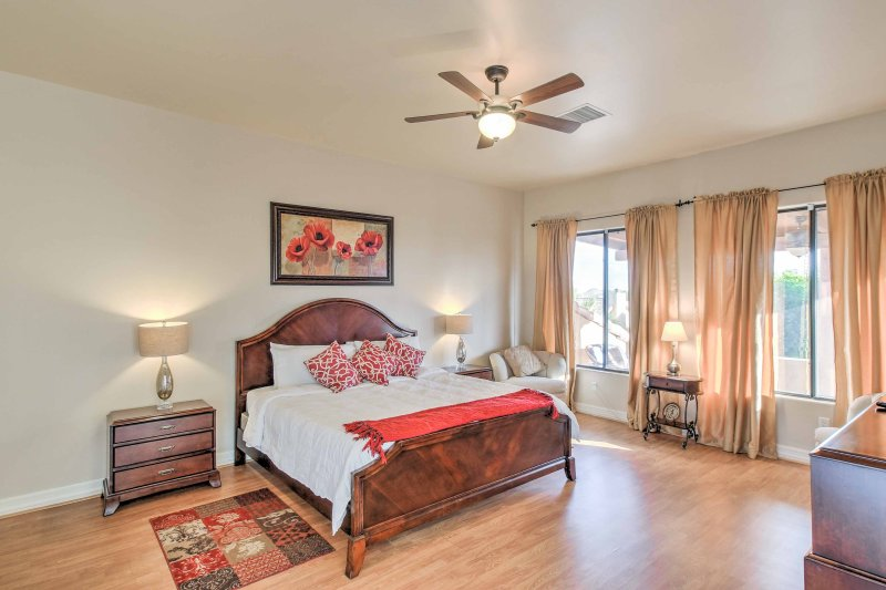 Two guests will sleep well in the master bedroom, which has a king-sized bed.