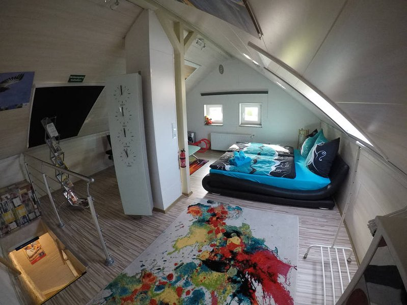 Spacious bedroom on the 1st floor with designer bed 180x200, designer sofa, TV, stereo