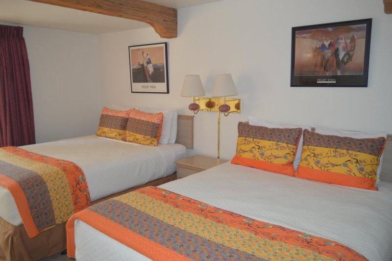 Camera da letto con 2 letti queen size