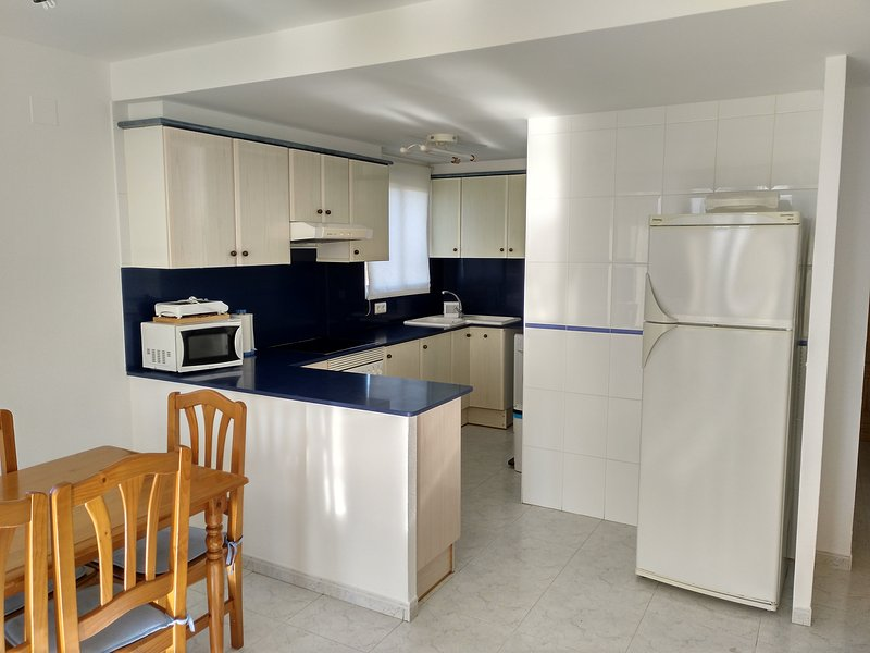Large kitchen, microwave, oven, sink 2 pools, washing machine and refrigerator 2 doors.