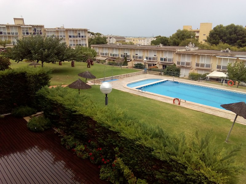 outdoor swimming pool and communal area, accessible from the beach.