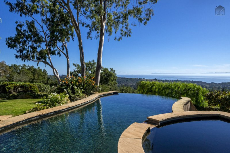 The terrace at Tuscan Charm boasts a heated infinity pool with amazing views of the ocean & islands
