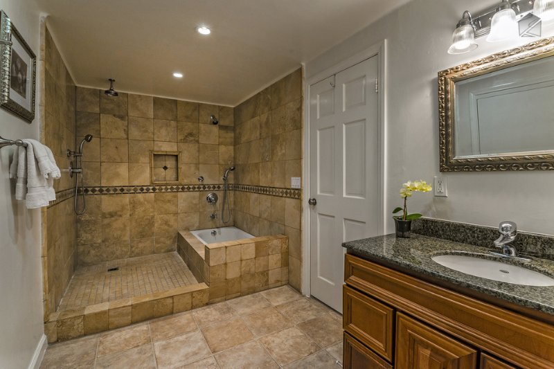The private bath in master bedroom #2 has a separate walk-in shower and soaking tub.