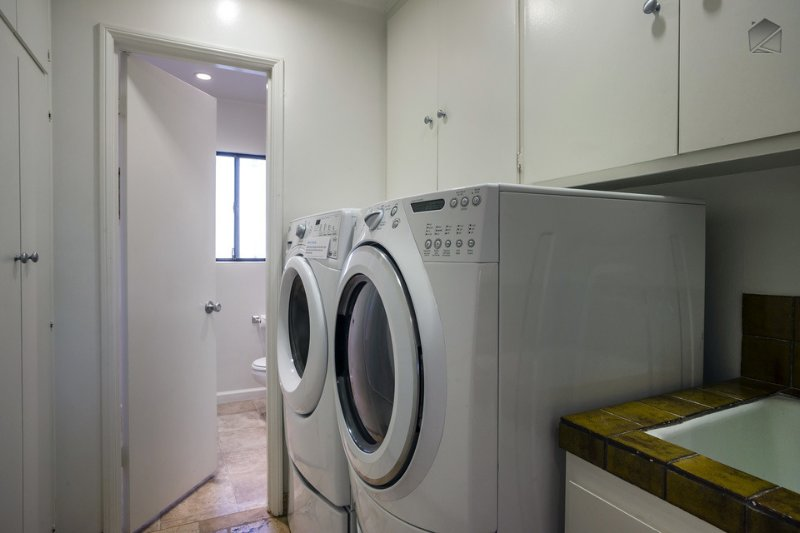 The laundry room has HE front-loading machines and a washing sink.