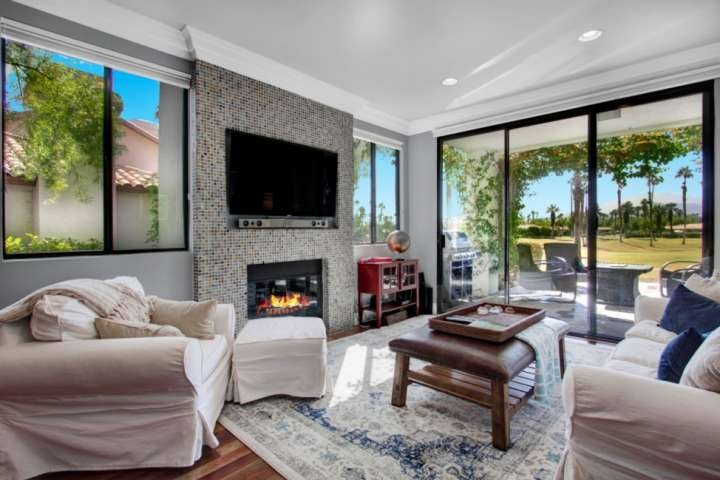 Bright and open living area, large screen HDTV, and a back patio and a view for miles!